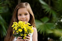 Portrait of a girl holding a bunch of flowers and smiling