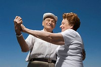Low angle view of a senior couple dancing