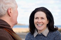 Mature woman looking at a senior man and smiling