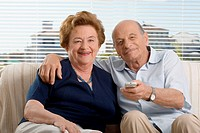 Portrait of a senior couple watching television