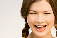 Close-up of a young woman laughing (thumbnail)