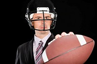 Close_up of a businessman wearing a football helmet