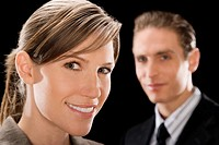Portrait of a businesswoman with a businessman behind her (thumbnail)