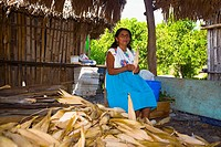 Mature woman peeling corn, Papantla, Veracruz, Mexico