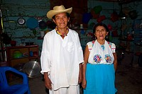 Portrait of a mature couple standing in a kitchen, Papantla, Veracruz, Mexico
