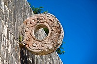 Circular carved stone on the wall, Ball Court Ring, Chichen Itza, Yucatan, Mexico