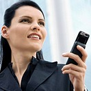 Close-up of a businesswoman using a mobile phone (thumbnail)