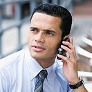 Close_up of a businessman using a mobile phone