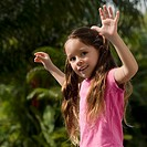 Close_up of a girl dancing in a park