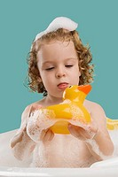 Close_up of a girl holding a rubber duck