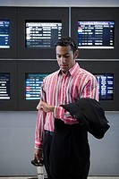 Businessman checking the time at an airport