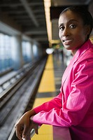 Portrait of a businesswoman standing at a subway station and smiling