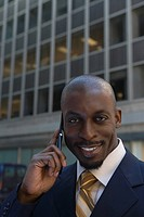 Portrait of a businessman talking on a mobile phone and smiling