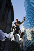 Low angle view of a businessman in mid_air