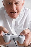 Close-up of a senior man playing a video game (thumbnail)
