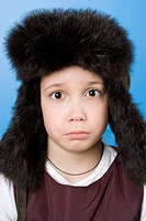 Portrait of a girl wearing a fur hat