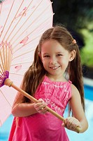 Portrait of a girl holding an umbrella and smiling