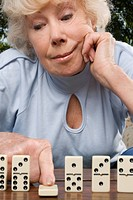 Close_up of a senior woman playing dice