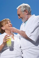 Low angle view of a senior couple looking at each other and smiling (thumbnail)