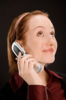 Close-up of a businesswoman talking on a mobile phone (thumbnail)