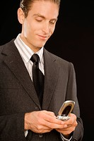 Close-up of a businessman text messaging (thumbnail)