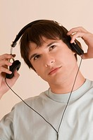 Close-up of a young man listening to music (thumbnail)