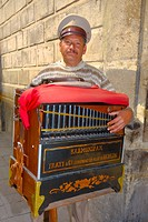 Portrait of a mature man holding a harmonipan, Mexico City, Mexico
