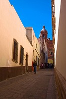 Man walking in an alley, Callejon De Veyna, Zacatecas City, Zacatecas State, Mexico