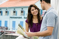 Couple holding a map and smiling