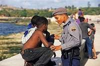 Police officer talking to some children, Havana, Cuba