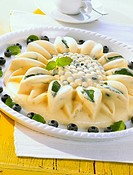Pineapple & blueberry ice cream cake in shape of a sunflower