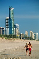 Couple walking along beach at the resort of Surfers Paradise on the Gold Coast of Queensland, Australia, Pacific