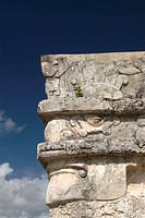 Mexico, Quintana Roo, Tulum, Temple of the Frescoes, stone mask carving on corner of building (represents an old god, either Itzamna or Chac)
