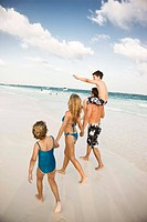 Family walking on beach in Playa del Carmen, Mexico