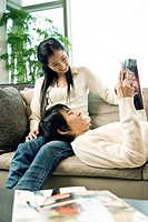 Young couple reading a magazine together
