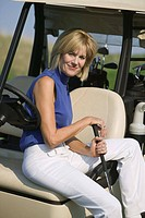 Woman sitting on golf cart