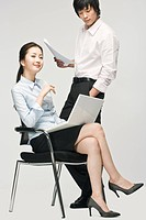 Business couple using laptop