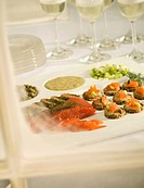 Appetizer Tray on a Table with Serving Plates and Glasses of Wine