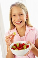 Young Girl Eating Fresh Fruit Salad
