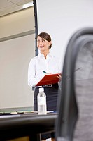 Smiling Latin American businesswoman in conference room