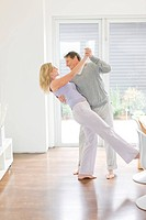 Couple dancing in dining room