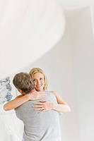 Portrait of couple hugging (thumbnail)