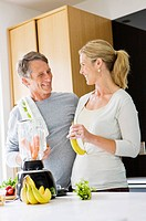 Couple preparing health shake in kitchen