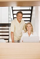 Portrait of couple using laptop
