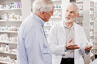 Pharmacist explaining medication to customer (thumbnail)