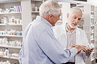 Customer asking pharmacist about medication