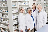Portrait of four smiling pharmacists