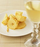 Fried onion & celeriac in batter with a glass of white wine