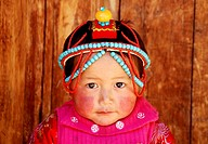 Tibetan little girl in Thangka festival