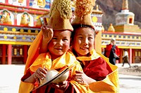 Two little Tibetan monks in Thangka festival.Tongren Qinghai,China